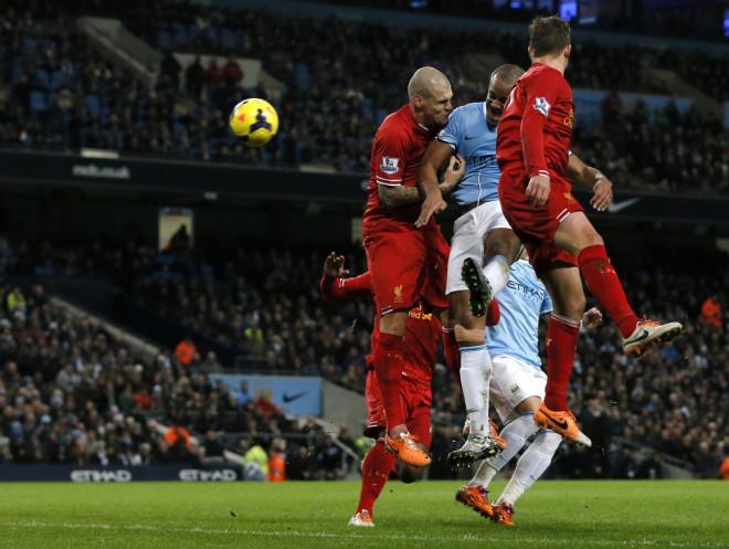 Vincent Kompany scores against Liverpool