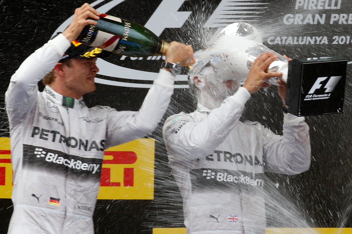 Nico Rosberg sprays champagne over his Mercedes Formula One team-mate Lewis Hamilton after he won the Spanish F1 Grand Prix at the Barcelona-Catalunya Circuit