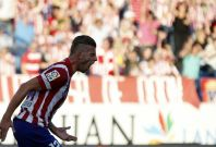 Atletico Madrid\'s Toby Alderweireld celebrates after scoring a goal against Malaga during their Spanish first division soccer match at Vicente Calderon stadium in Madrid May 11, 2014.