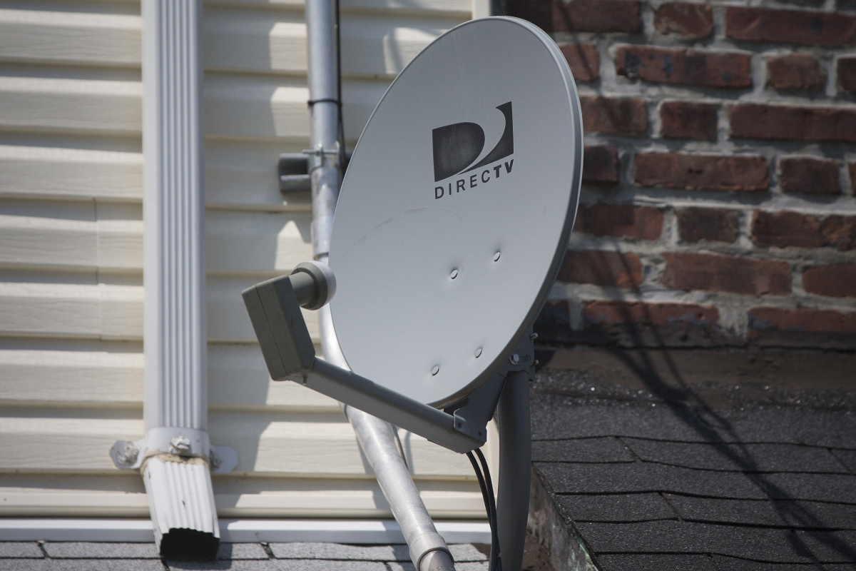 A DirecTV dish is seen outside a home in the Queens borough of New York