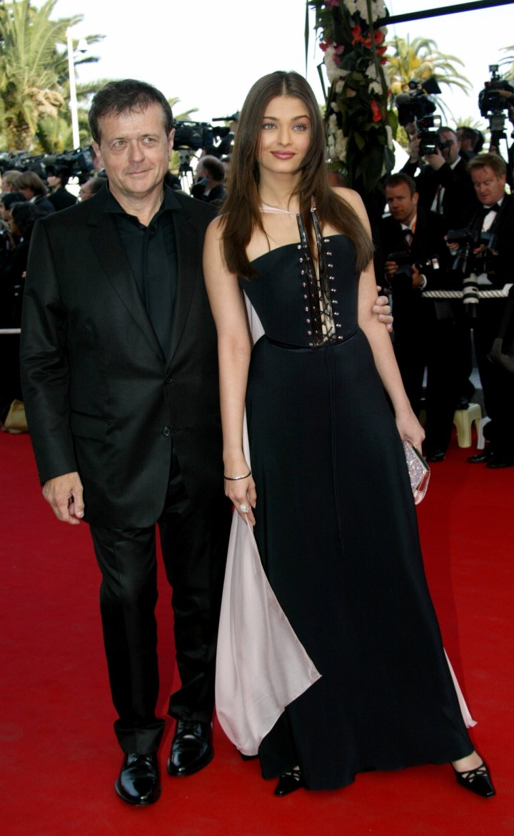 Jury President, French director Patrice Chereau (L), escorts jury member, Indian actress and a former Miss World, Aishwarya Rai (R) during red-carpet arrivals at the 56th International Film Festival in Cannes, May 15, 2003.