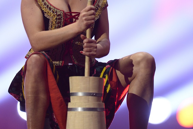 Milk maid churning butter with her cleavage rampant shocked British Eurovision judge, Laura Wright