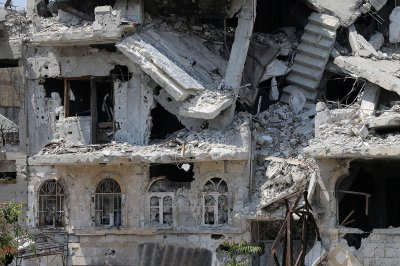 A heavily damaged building in a destroyed neighbourhood of the Old City of Homs