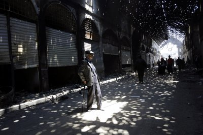Rays of light burst through holes in the roof of Maskuf covered market, or Souk,  in the Old City of Homs