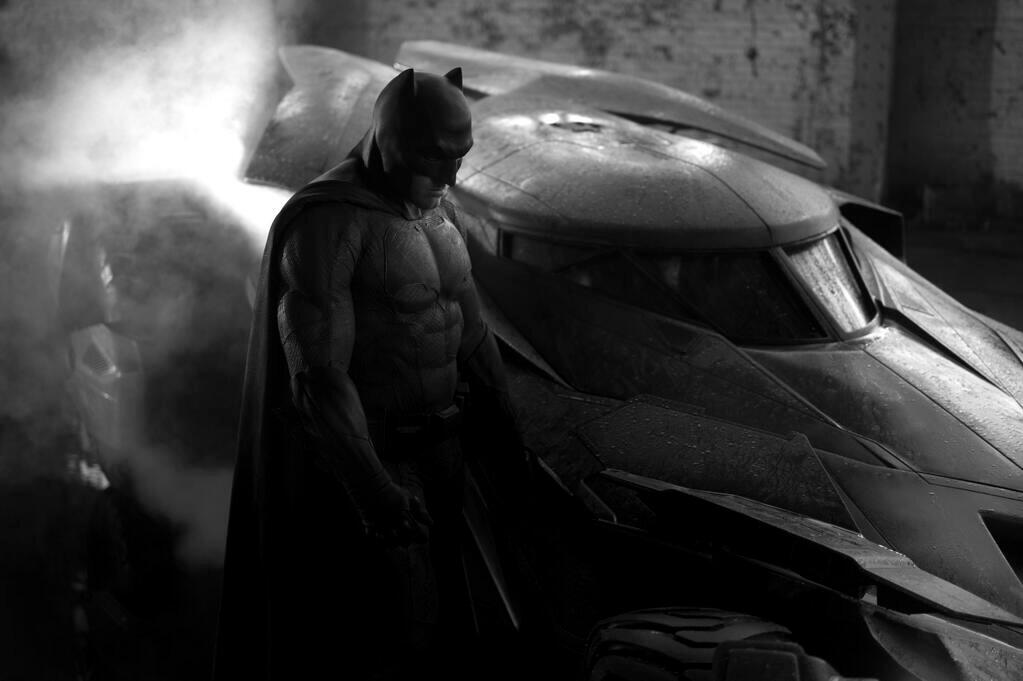 Ben Affleck as Batman and the new Batmobile