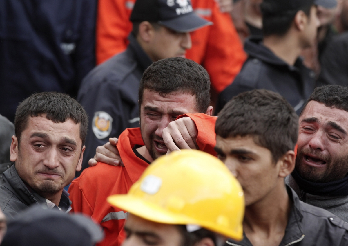 Relatives of miners who were killed or injured in a mine explosion react as rescuers work in Soma, a district in Turkey's western province of Manisa