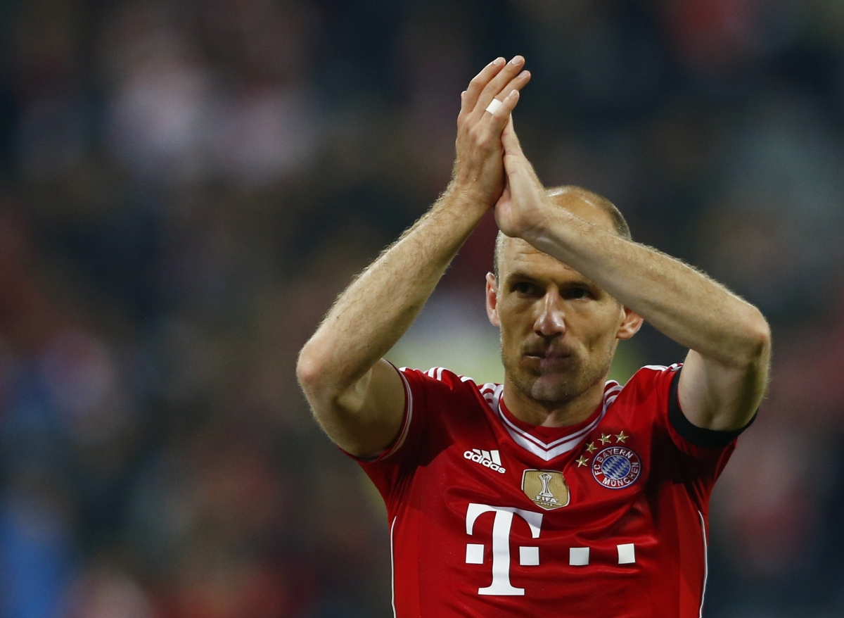 Bayern Munich's Arjen Robben walks out the pitch after the Champions League semi-final second leg soccer match against Real Madrid at the Arena stadium in Munich, April 29, 2014.
