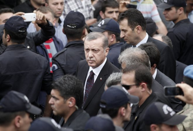 Turkey's Prime Minister Tayyip Erdogan (C) walks during his visit to Soma, a district in Turkey's western province of Manisa, after a coal mine explosion