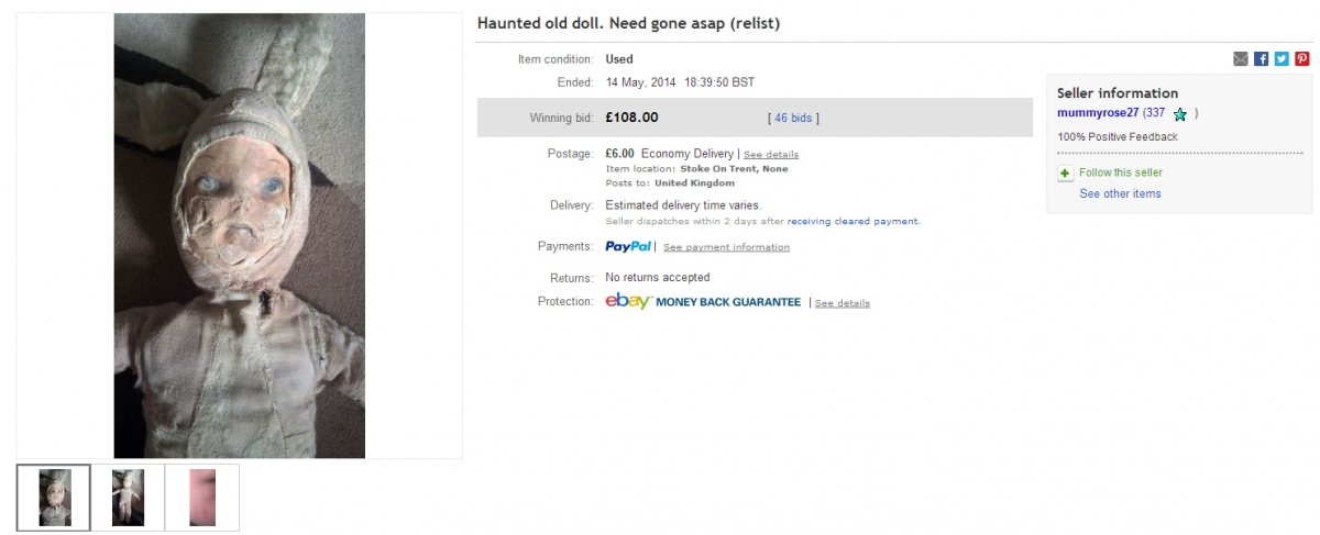 A haunted old doll that has sold on eBay for £108 with 46 bids