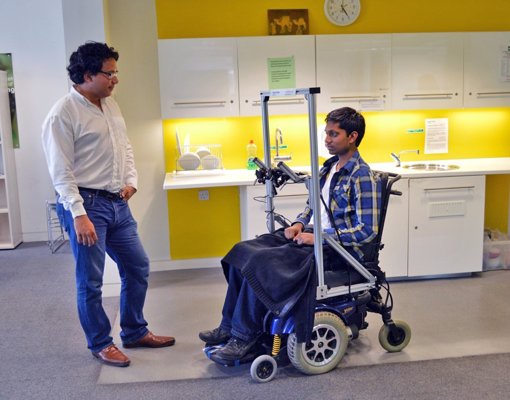 Dr Aldo Faisal (left) and Kirubin Pillay demonstrate hands-free wheelchair driving using a prototype that cost £20