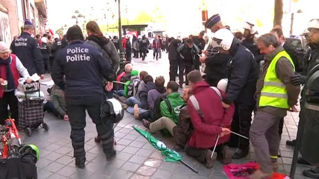 Hundreds Clash with Police Over US-EU Trade Pact