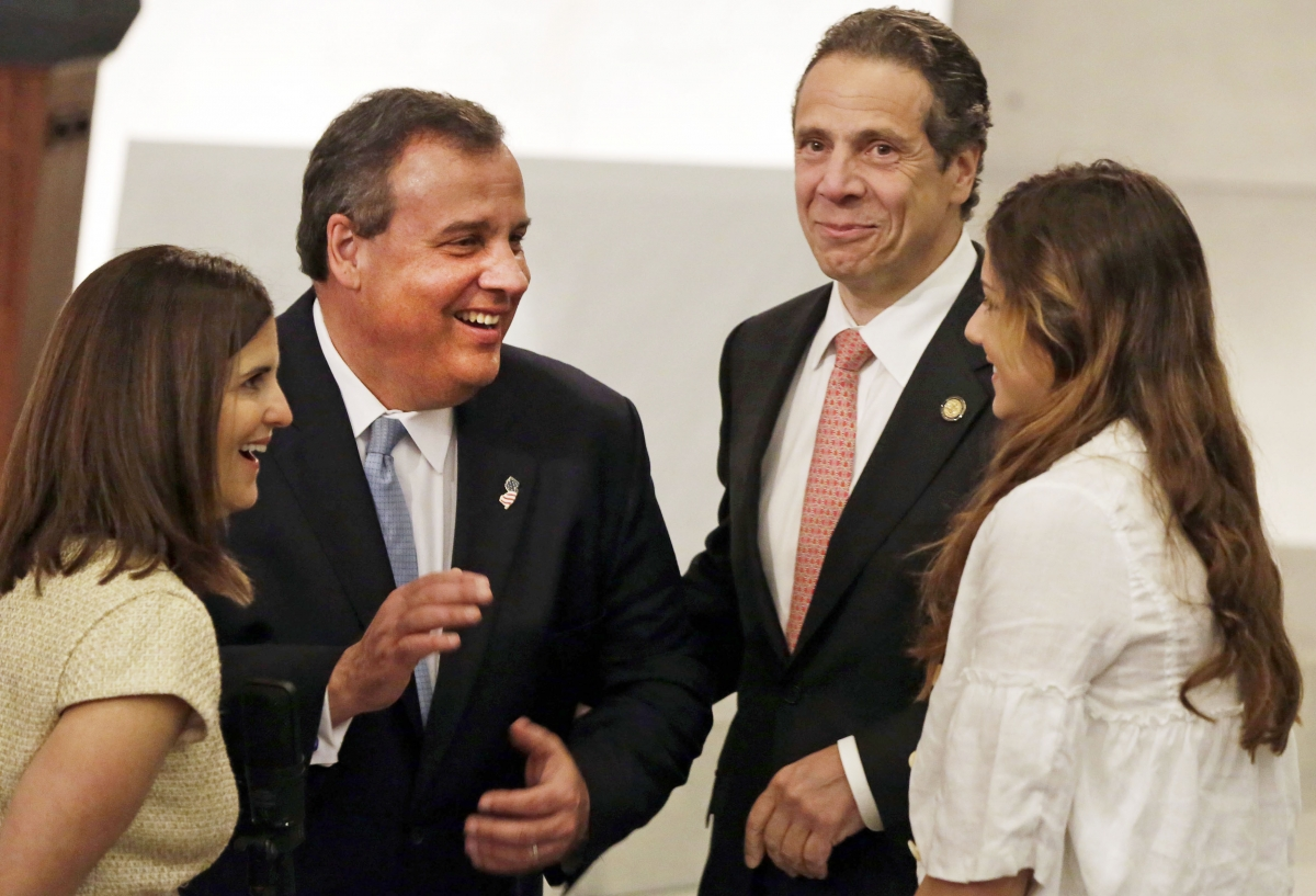New Jersey Governor Chris Christie (2nd L), with his wife Mary Pat Christie (L), and New York Governor Andrew Cuomo and his daughter Michaela Cuomo (R), meet during the dedication ceremony in Foundation Hall, of the National September 11 Memorial Museum