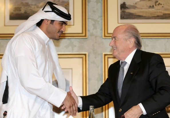 Sheikh Mohammed bin Hamad al-Thani (L) shakes hands with FIFA president Sepp Blatter
