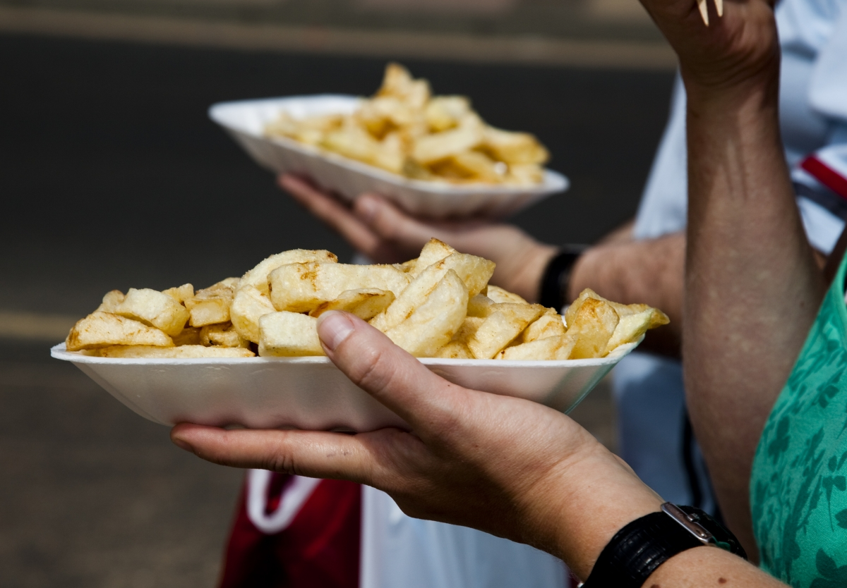 Scarborough chip eaters confirming Chinese beliefs about Brits' fondness for the spud.