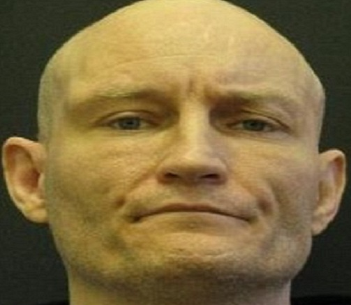 Arnold Pickering has escaped from jail and wears the Nazi symbol of the Swastika as a tattoo