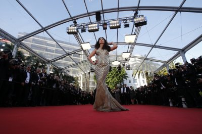 Aishwarya Rai Makes Dazzling Appearance in Gold at Cannes