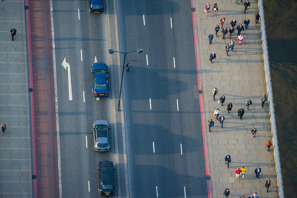 Commuters crossing the Thames using London Bridge