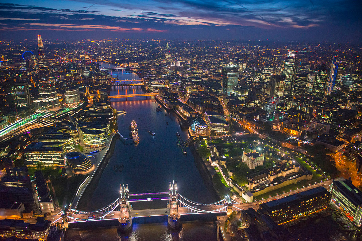 Tower Bridge and the Tower of London at night showing The Shard and the City