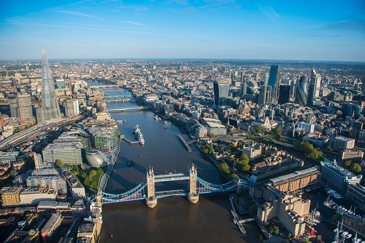 Daytime view from Tower Bridge down the Thames showing the City and The Shard