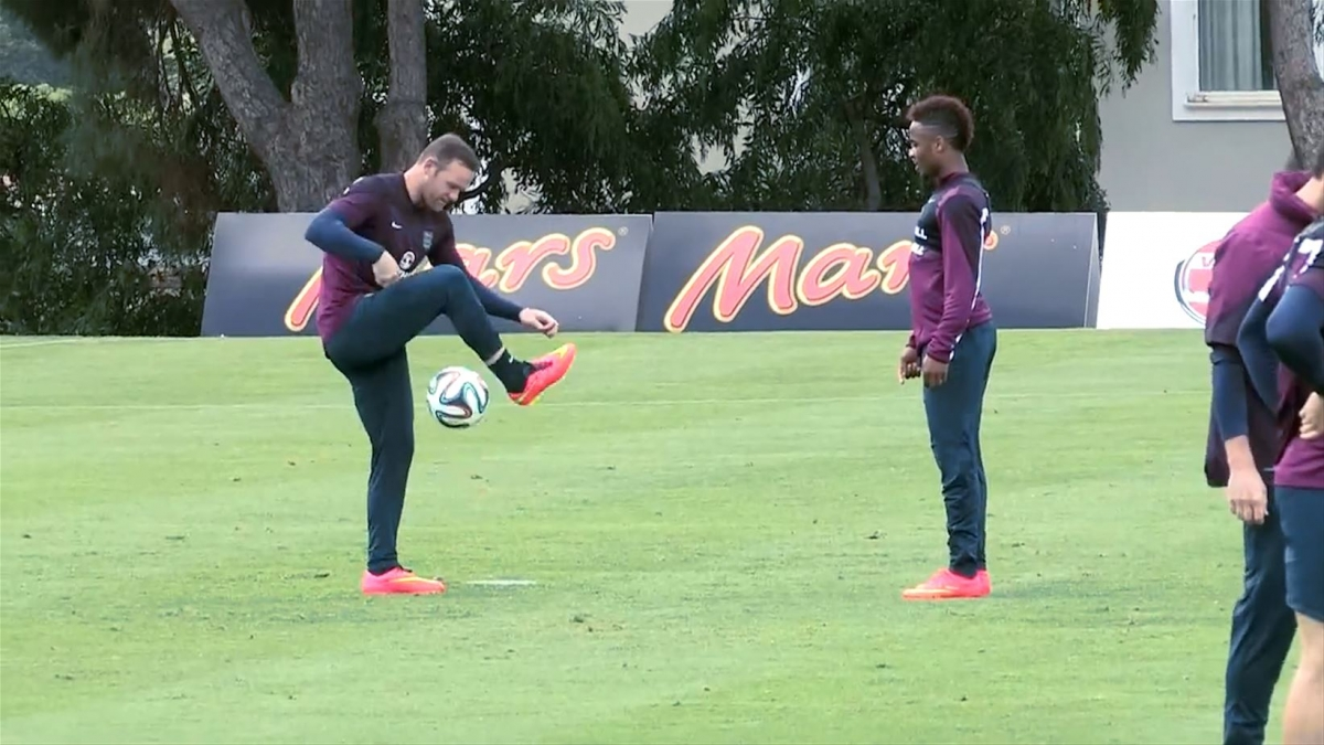 Wayne Rooney Shows Off his Skills to Raheem Sterling During England Training