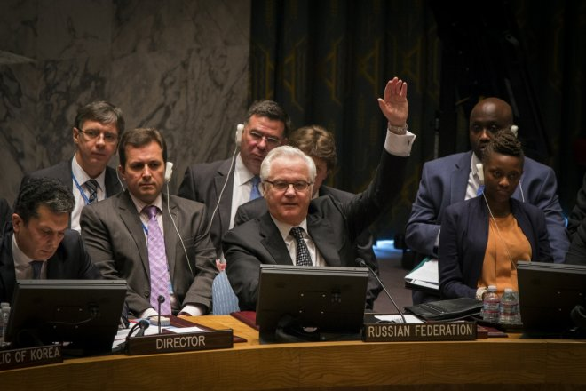 Russia's UN Ambassador Vitaly Churkin votes in the United Nations Security Council against referring the Syrian crisis to the International Criminal Court for investigation of possible war crimes