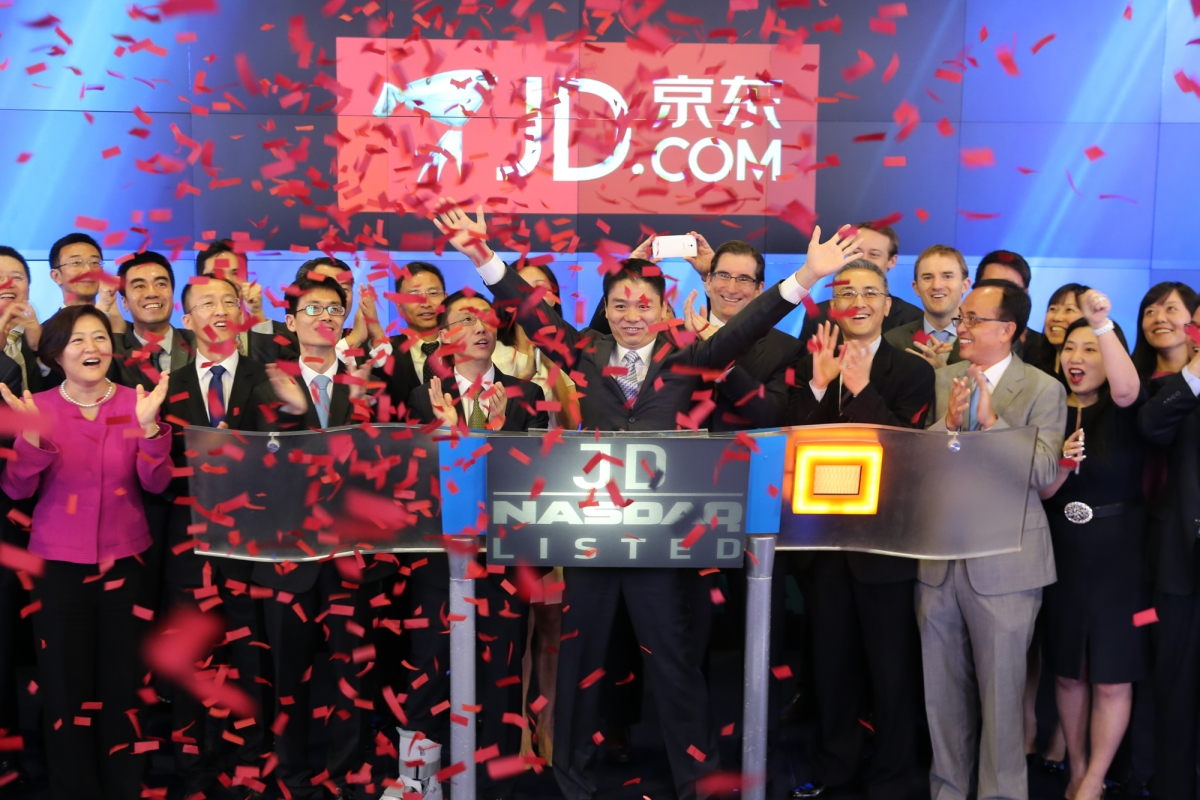 Richard Liu, Chairman & Chief Executive Officer of JD.com with other staff