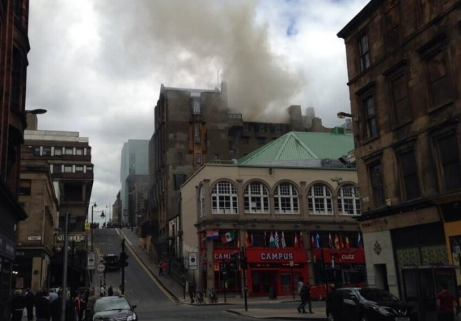 Smokes pours from the Glasgow School of Art, which caught fire on Friday afternoon