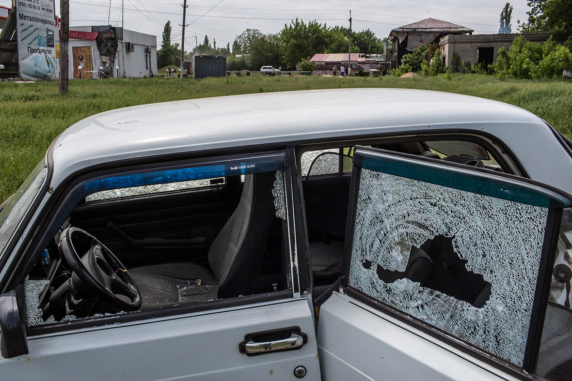 A car is riddled with bullet holes at the scene of an early morning fire fight eastern Ukraine.