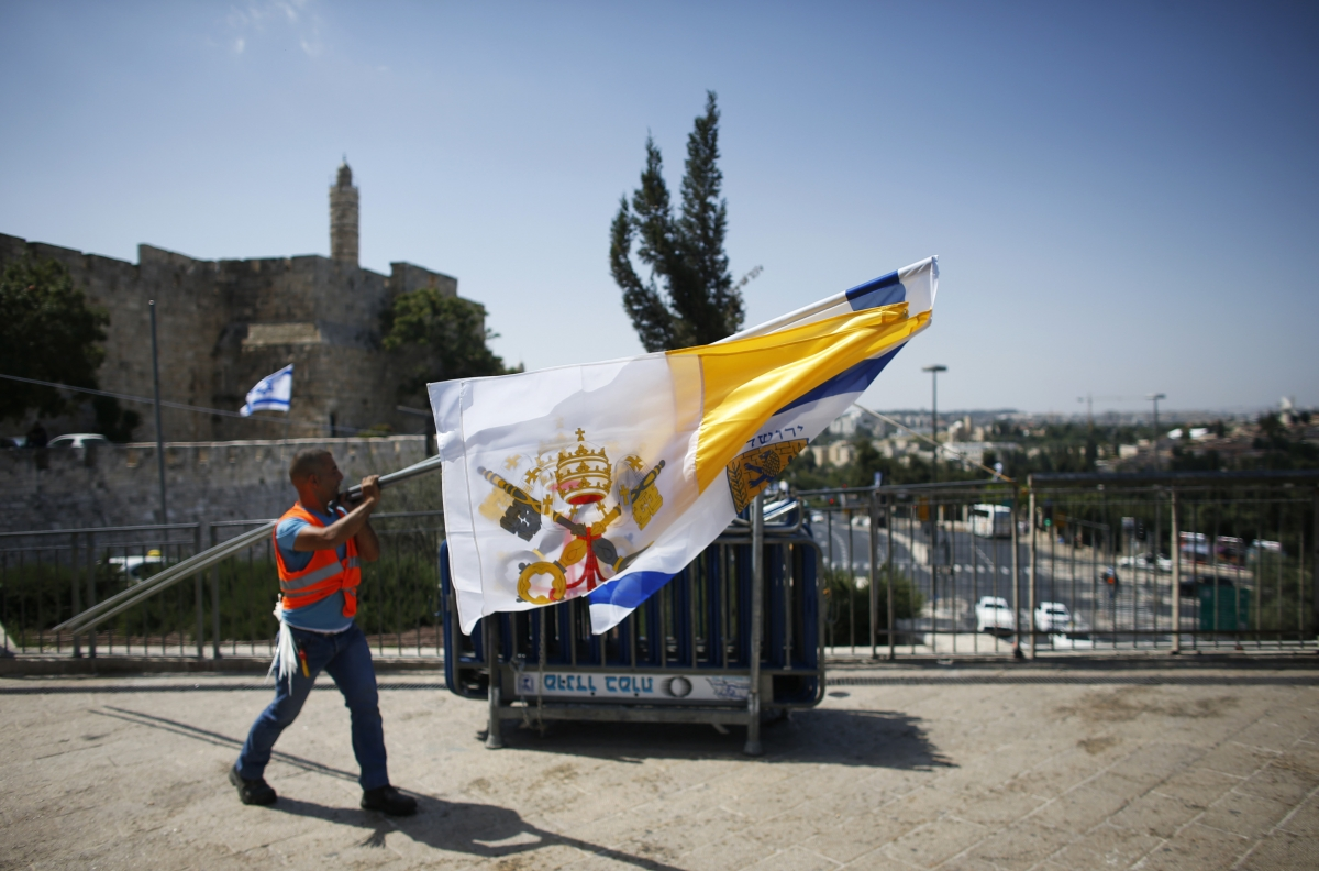 The Vatican flag is hung just outside Jerusalem's Old City in preparation for Pope Francis' visit, his first to the region