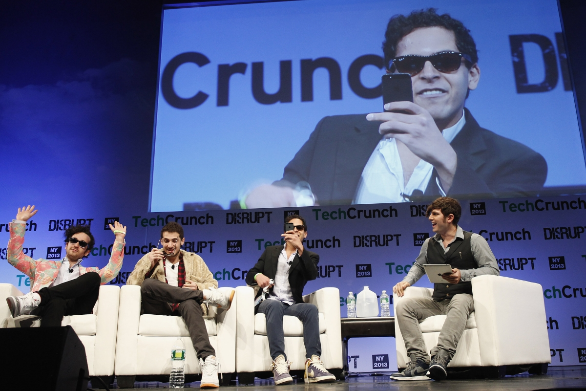 Mahbod Moghadam (centre with phone) lords it up at a TechCrunch event, last year