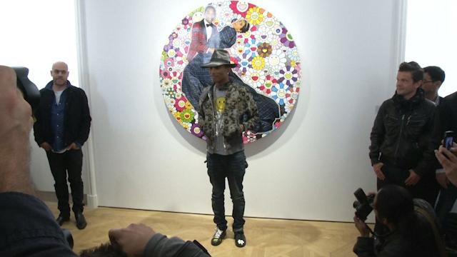 Pharrell Williams Opens 'G I R L' Exhibition in Paris