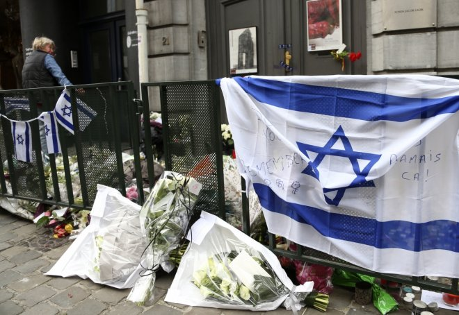A woman stands at the entrance of the closed Jewish Museum in Brussels