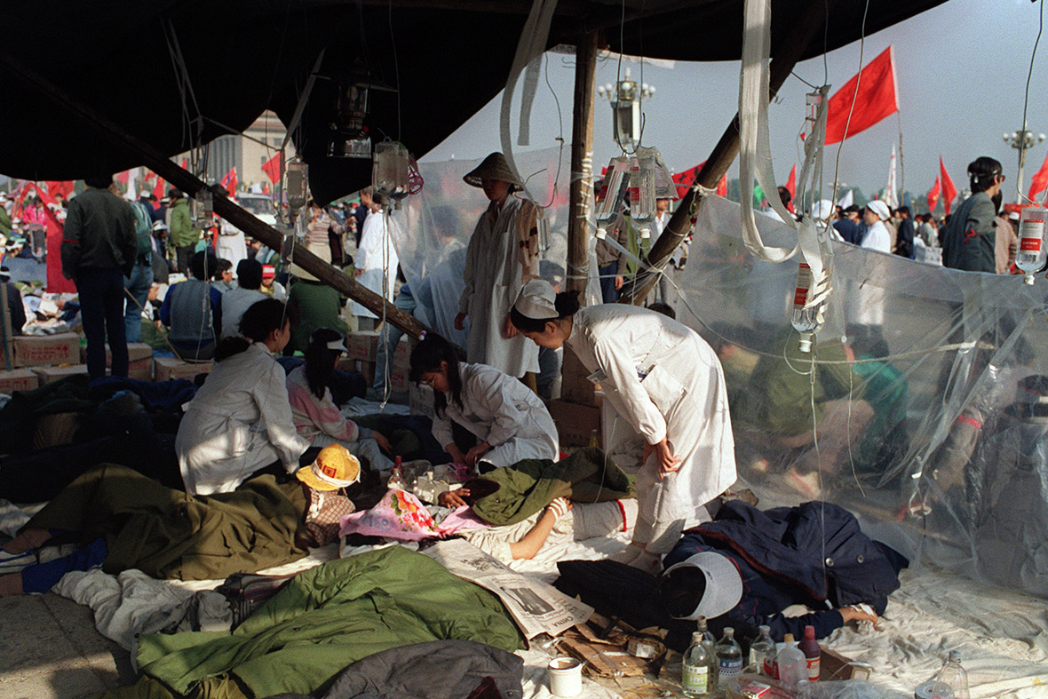 17 May 1989 Students from Beijing University receive first aid in a makeshift tent in Tiananmen Square, during the fifth day of their hunger strike