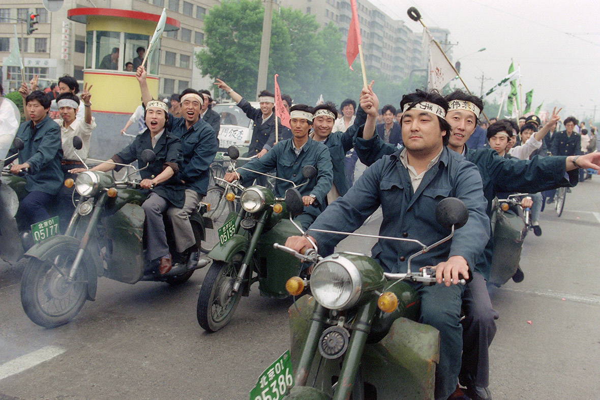 18 May 1989 Chinese workers parade through Beijing streets on motorbikes in support of  hunger strikers in Tiananmen Square