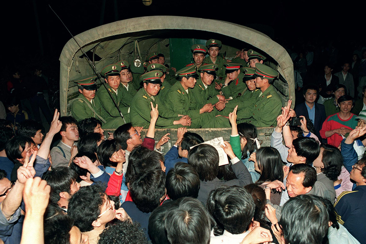 20 May 20, 1989 Pro-democracy demonstrators stop a truck filled with soldiers on its way to Tiananmen Square after martial law was invoked