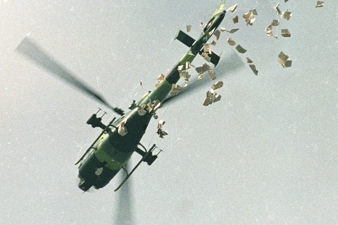 22 May 1989 A military helicopter drops leaflets warning the student protesters to leave Tiananmen Square
