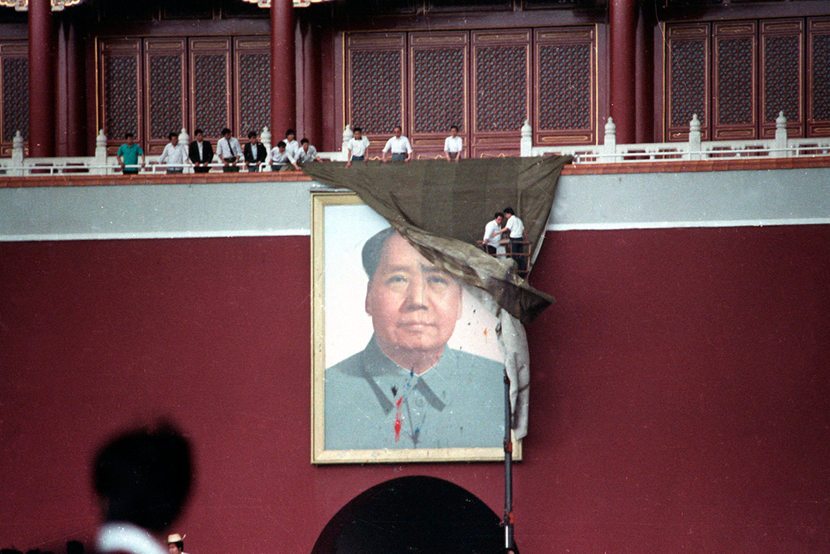 23 May 1989 Workmen cover Tiananmen Squares portrait of Mao Tse-tung after it was pelted with paint