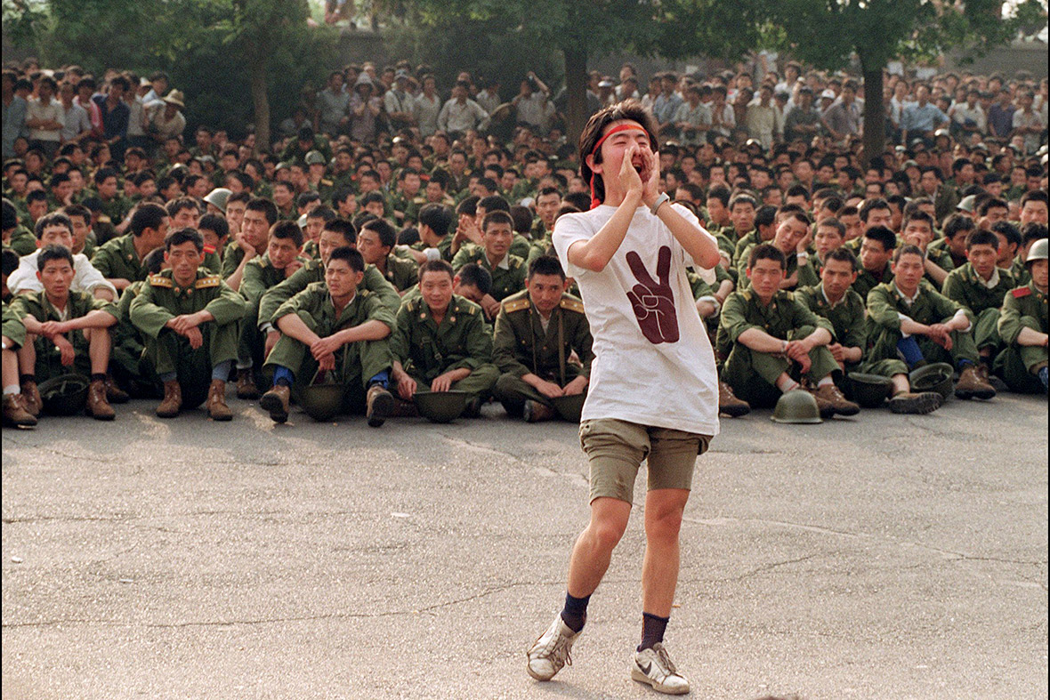 3 June 1989 A dissident student asks soldiers to go back home as crowds flood into central Beijing