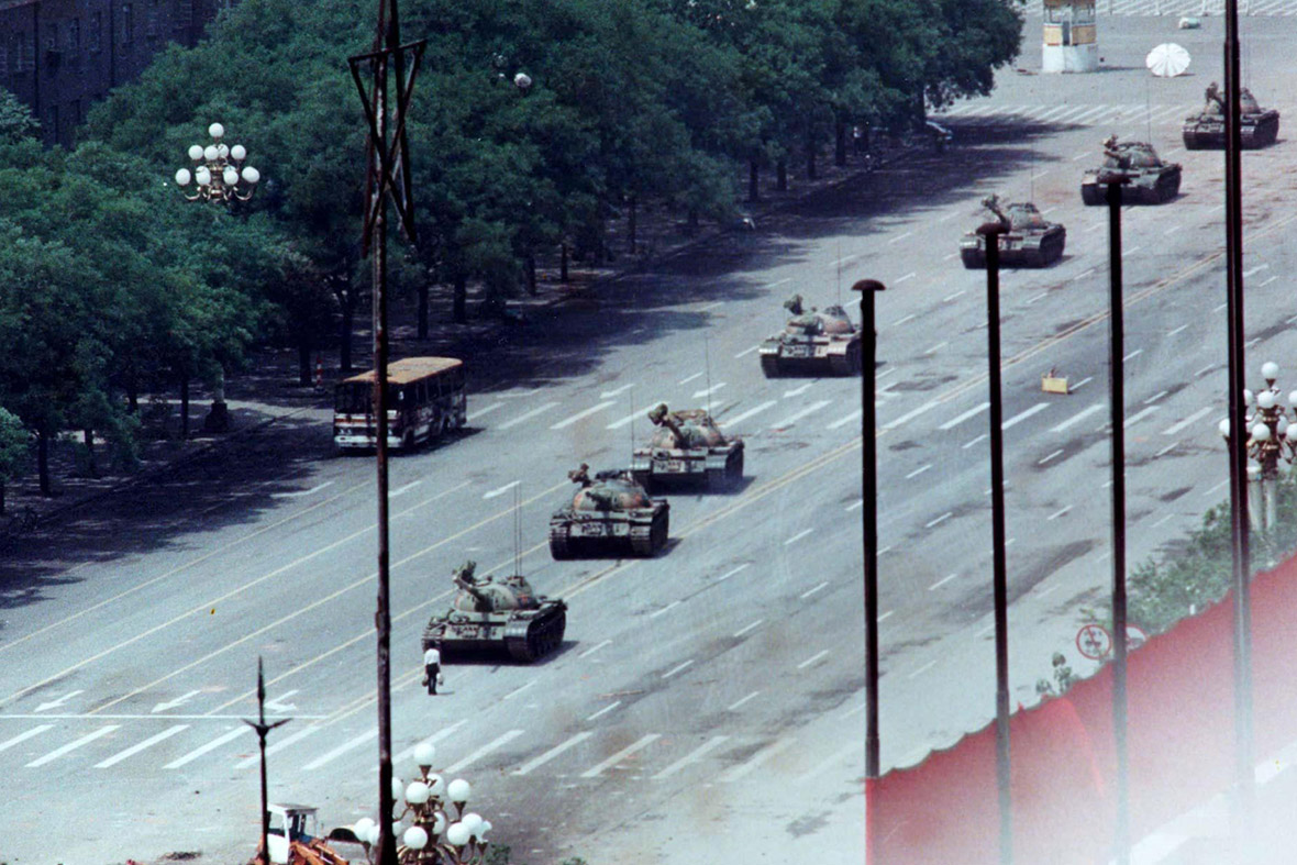tank man stands in front of a column of tanks in the Avenue of Eternal Peace, the day after the Tiananmen Square uprising was crushed