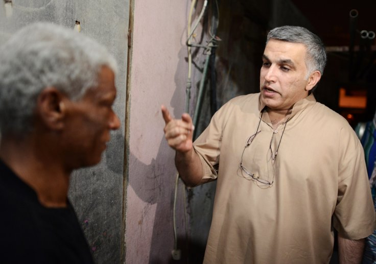 Activist Nabeel Rajab (R) speaks to his neighbour after his release from jail, in the village of Bani Jamra, west of Manama