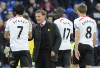 Liverpool\'s manager Brendan Rodgers (C) congratulates Luis Suarez after scoring a hat trick against Cardiff City during their English Premier League soccer match at Cardiff City Stadium in Cardiff, Wales, March 22, 2014.