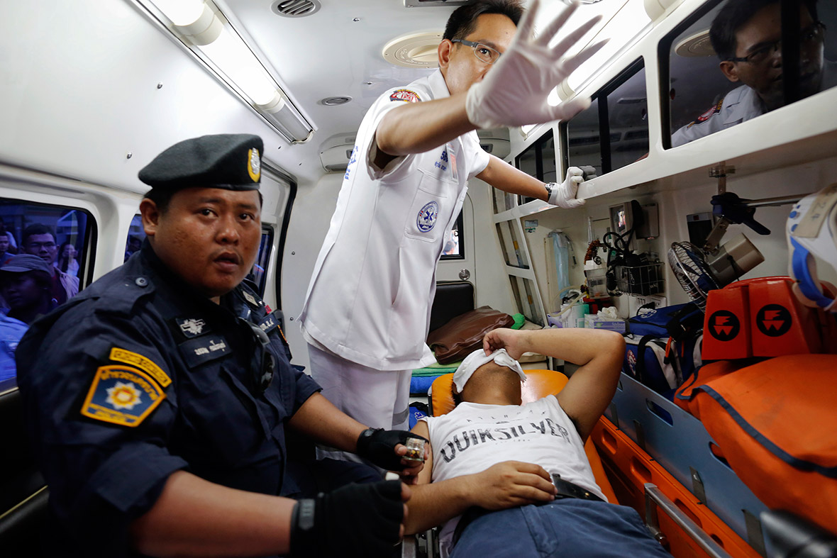 An injured policeman is treated inside an ambulance after confronting anti-coup protesters