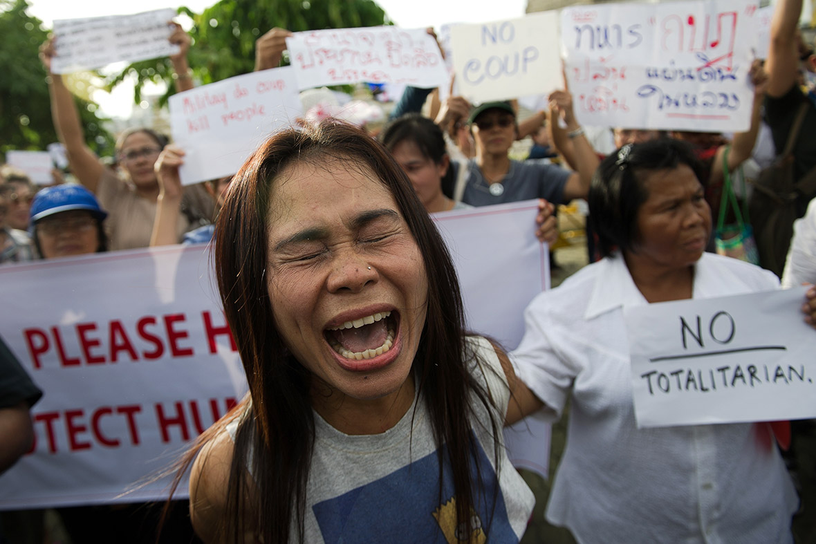 People protest during an anti-coup rally at the Victory Monument in Bangkok