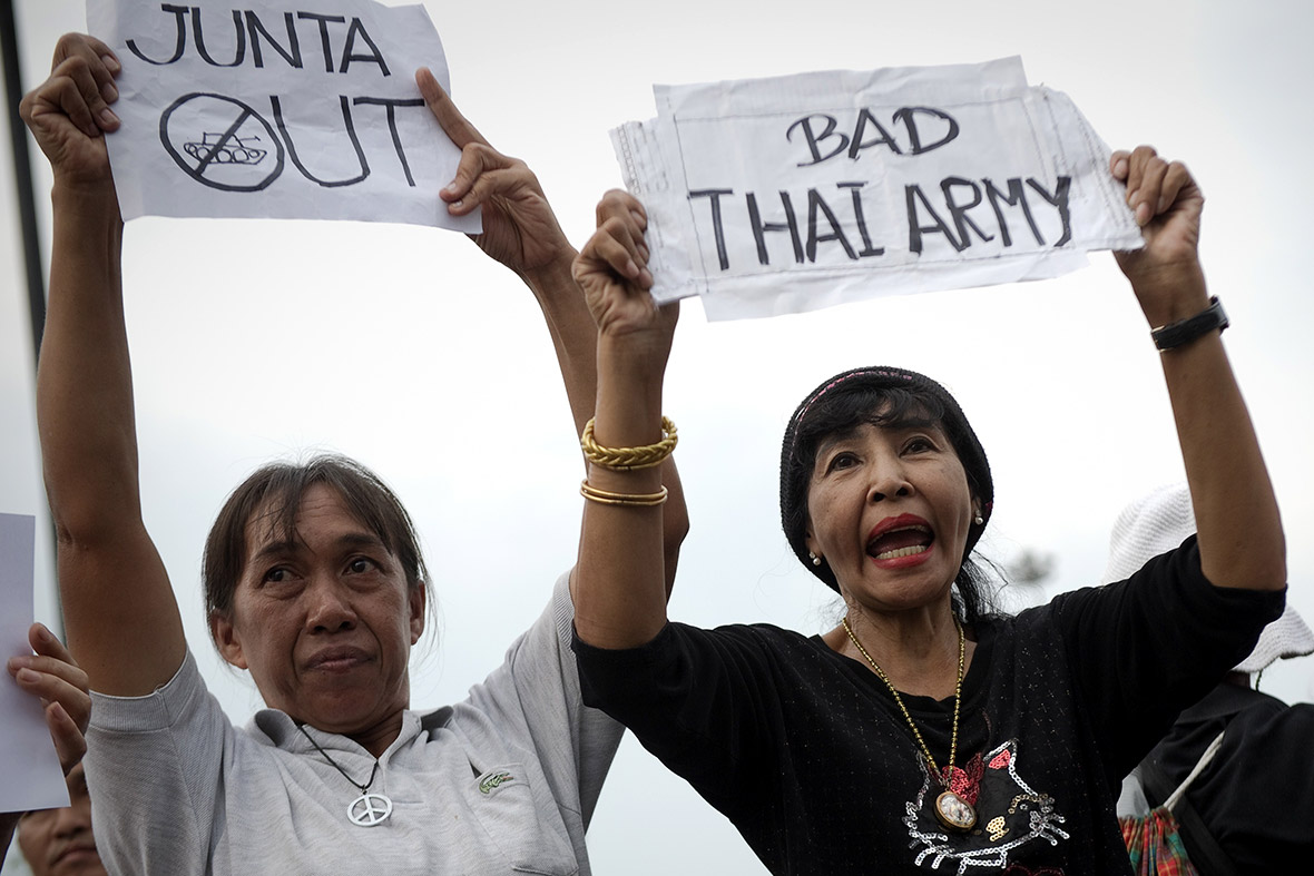 Anti-coup protesters displays banners demanding the junta ends during a rally at the Victory Monument