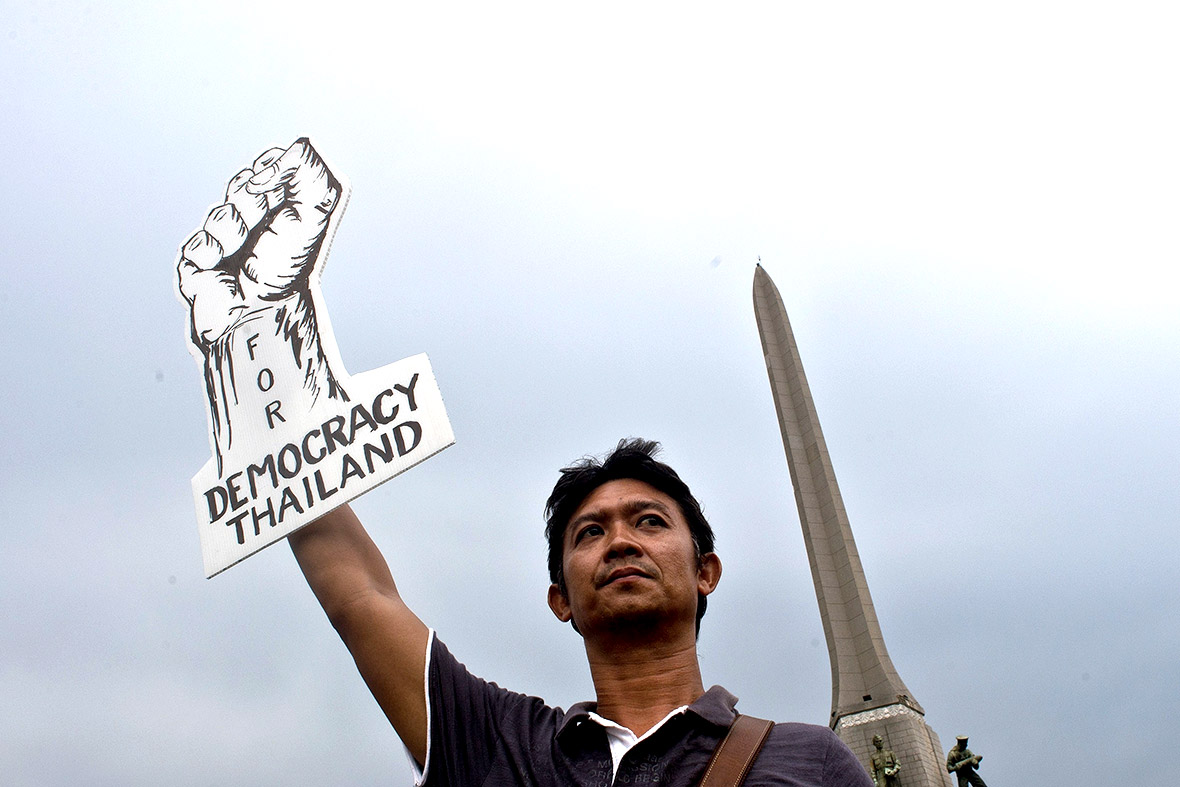 A pro-democracy protester takes part in a gathering at Bangkoks Victory Monument