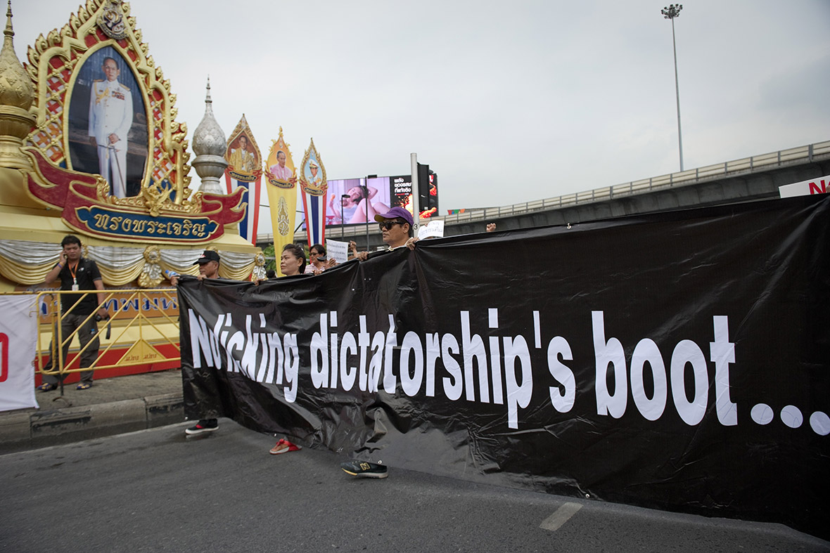 Anti-coup protesters hold a banner that reads