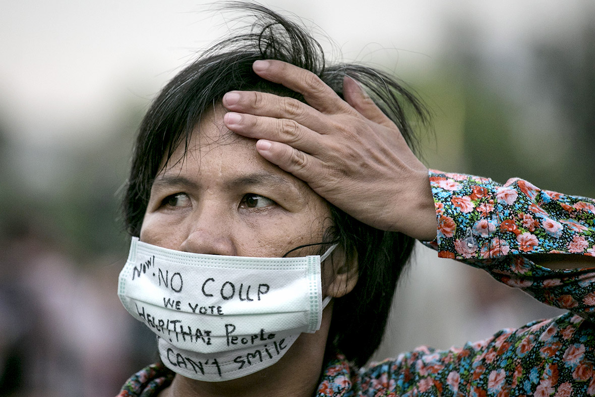 A protester wears a face mask that read