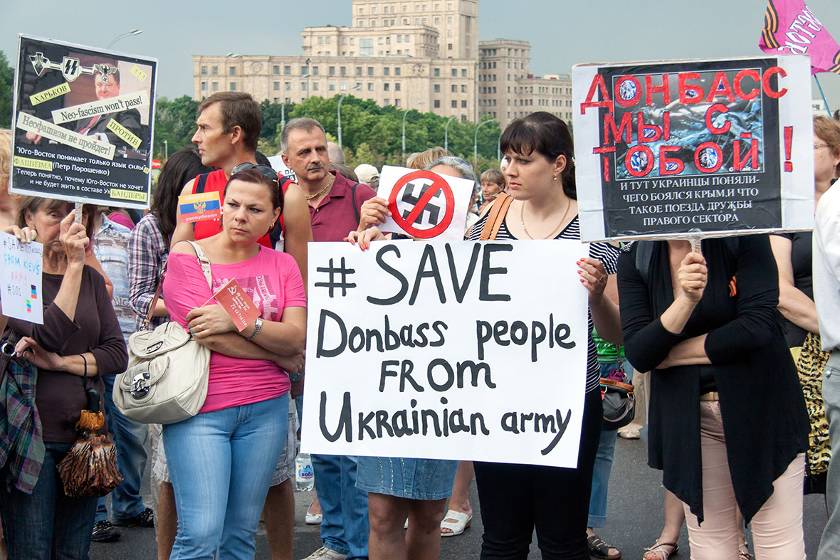 Pro-Russian supporters hold placards reading