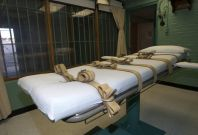 The death chamber and the steel bars of the viewing room are seen at the federal penitentiary in Huntsville, Texas