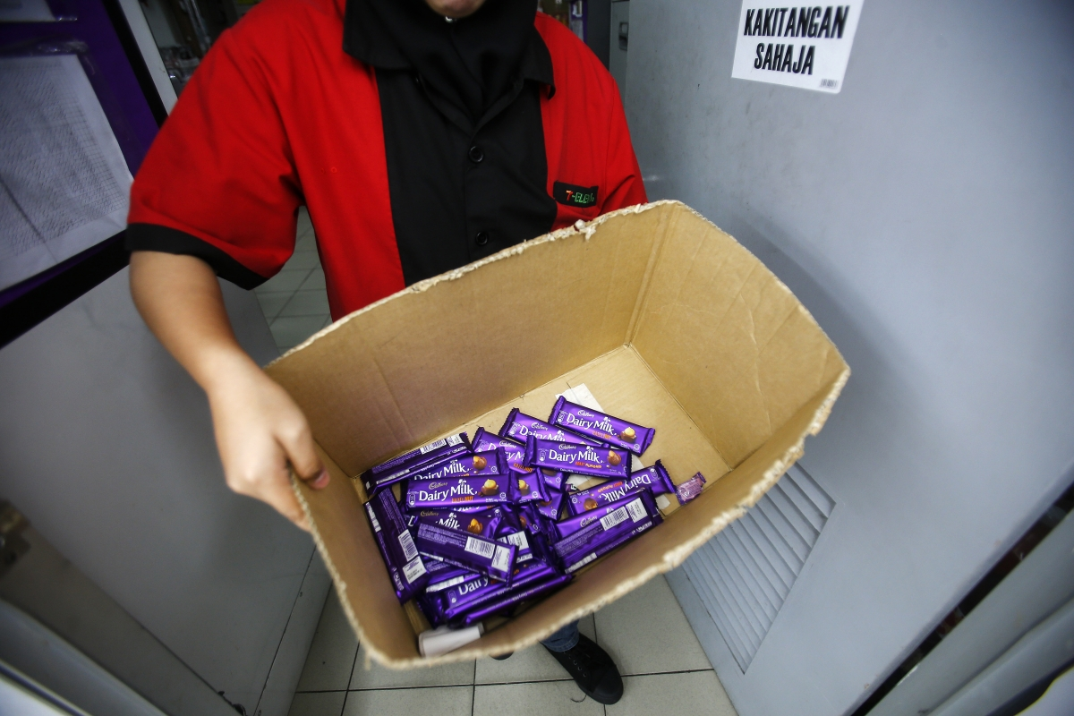 a box containing Cadbury Dairy Milk Hazelnut and Cadbury Dairy Milk Roast Almon